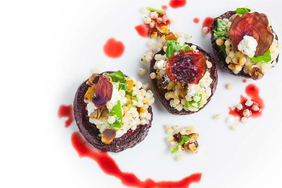 ​Chef Adrianne Calvo's Roasted Beets With Goat Cheese & Garlic Pearl Couscous Is a Foodie Favorite