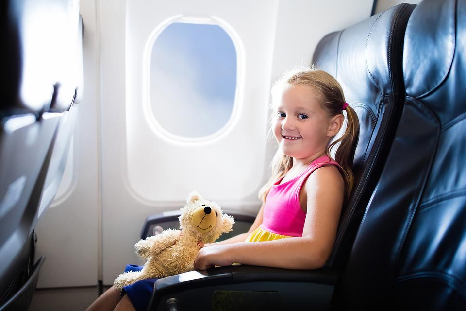 Flying With Kids: 13 Ways to Make Traveling With Children Easier!