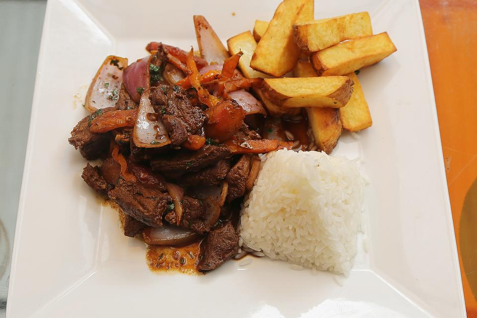 Peruvian Lomo Saltado Recipe: A Traditional Beef Stir-fry Recipe From Peru (Served With Fries!)