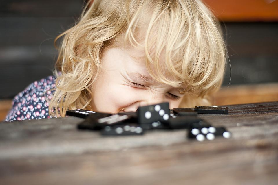 Stuck Inside With Kids? Dominoes Keep Them Busy & Creative!