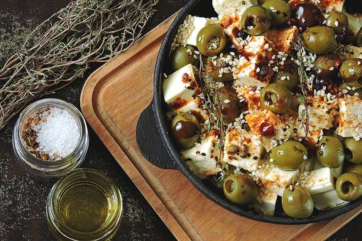 Olive Recipes: Baked Olives With Feta & Fresh Herbs Is a Charcuterie Board Lover's Dream