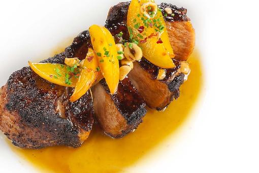 Chef Adrianne Calvo's Double-Cut Pork Chops With Spicy Peaches & Roasted Hazelnuts