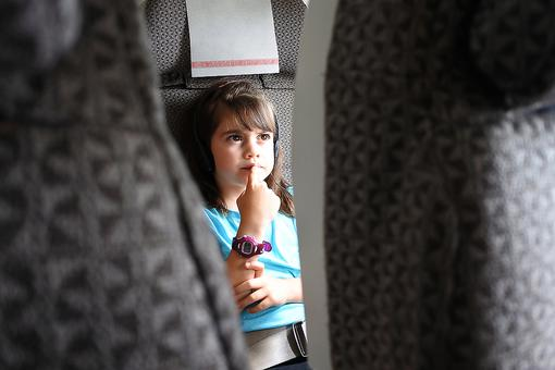 Antsy Kids on Airplanes: This Trick Will Help Kids Sit During Air Travel!