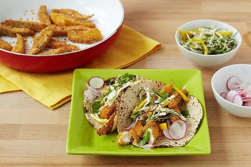 How to Make Polenta-Crusted Fish Tacos With Spicy Mango Slaw!