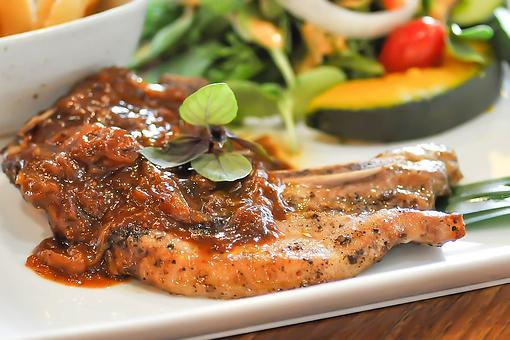 4-Ingredient Cajun Pork Chops Recipe: Pork Chops Smothered in an Irresistible Cajun Tomato Gravy Are Ready in 20 Minutes