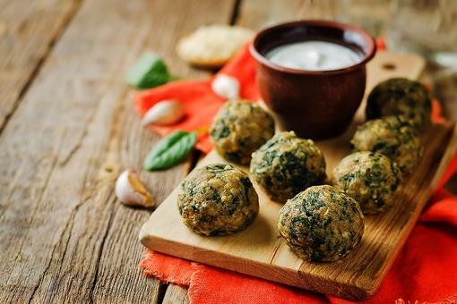This Parmesan Spinach Balls Recipe Will Help You Become MVP at Your Next Tailgating Party